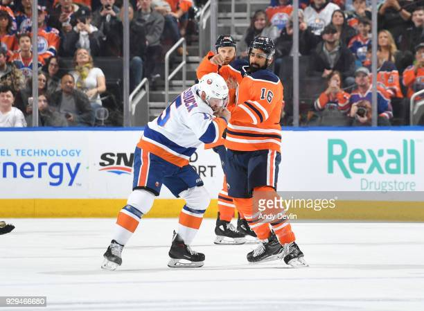 Jujhar Khaira of the Edmonton Oilers fights against Cal Clutterbuck of the New York Islanders on March 8 2018 at Rogers Place in Edmonton Alberta...