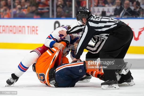 Jujhar Khaira of the Edmonton Oilers fights Brendan Lemieux of the New York Rangers during the second period at Rogers Place on March 11 2019 in...
