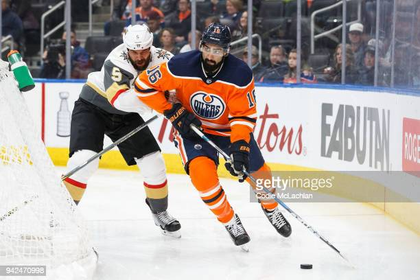 Jujhar Khaira of the Edmonton Oilers is pursued by Deryk Engelland of the Vegas Golden Knights at Rogers Place on April 5 2018 in Edmonton Canada