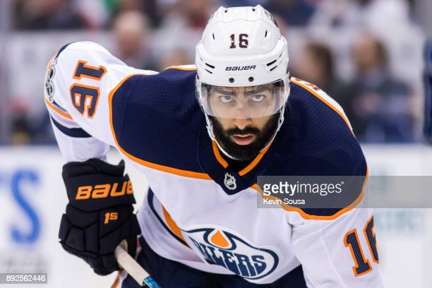 Jujhar Khaira of the Edmonton Oilers sets to take a faceoff against the Toronto Maple Leafs during the third period at the Air Canada Centre on...