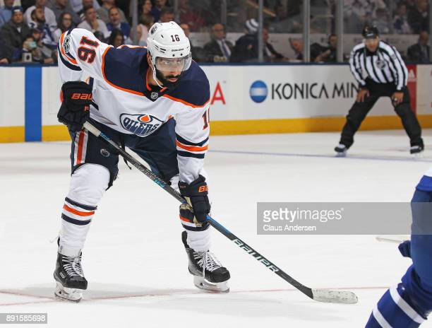 Jujhar Khaira of the Edmonton Oilers waits for a faceoff against the Toronto Maple Leafs during an NHL game at the Air Canada Centre on December 10...