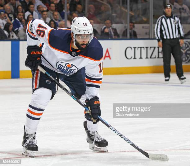 Jujhar Khaira of the Edmonton Oilers waits for a puck drop against the Toronto Maple Leafs during an NHL game at the Air Canada Centre on December 10...