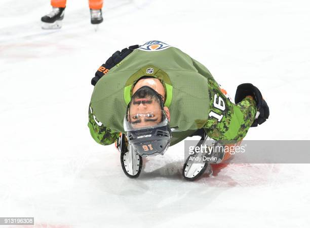 Jujhar Khaira of the Edmonton Oilers warms up in a green jersey in honour of armed forces appreciation night to the game against the Colorado...