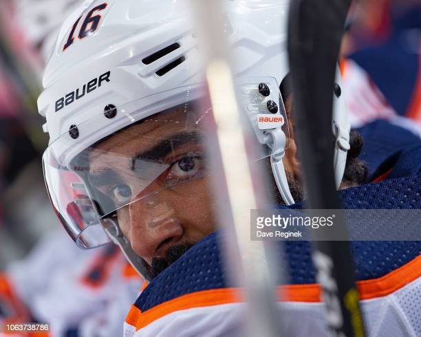 Jujhar Khaira of the Edmonton Oilers watches the action from the bench against the Detroit Red Wings during an NHL game at Little Caesars Arena on...