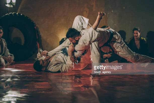 jujitsu skills on practice - wrestling stock pictures, royalty-free photos & images