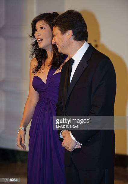 JuJu Chang and Neal Shapiro arrive for the state dinner in honour of South Korea's President Lee MyungBak and his wife Kim YoonOk October 13 2011 at...
