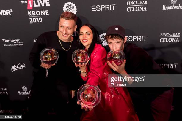 Juju Henning May and Felix Lobrecht with the 1Live Krone radio award at Jahrhunderthalle on December 5 2019 in Bochum Germany