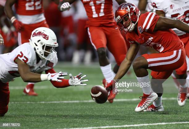 Juju Hughes of the Fresno State Bulldogs and Kyle Postma of the Houston Cougars look to pounce on a loose ball during the third quarter of the Hawaii...