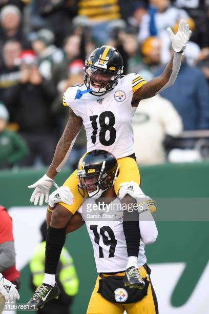 JuJu Smith-Schuster carries Diontae Johnson of the Pittsburgh Steelers on his shoulders after Johnson's touchdown during the first half of the game...