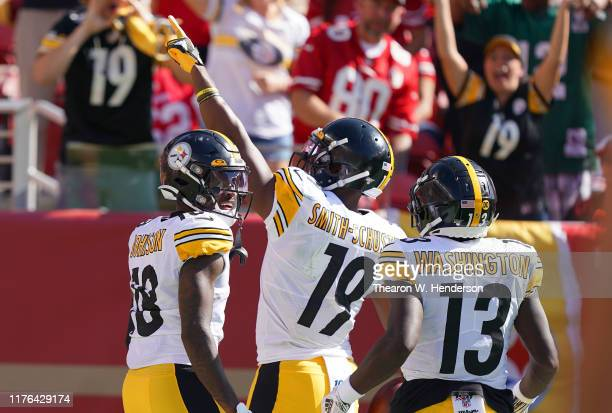 JuJu Smith-Schuster James Washington and Diontae Johnson of the Pittsburgh Steelers celebrates after Smith-Schuster caught a pass and broke away for...
