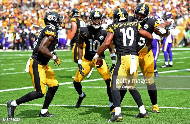 JuJu SmithSchuster of the Pittsburgh Steelers celebrates with teammates after a 4 yard touchdown reception in the second quarter during the game...