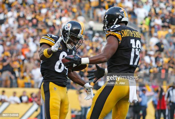 JuJu SmithSchuster of the Pittsburgh Steelers celebrates with Antonio Brown after a 31 yard touchdown reception in the second quarter during the game...