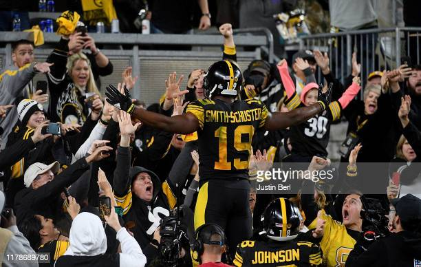 JuJu Smith-Schuster of the Pittsburgh Steelers celebrates with the crowd after a 26-yard touchdown reception in the third quarter during the game...