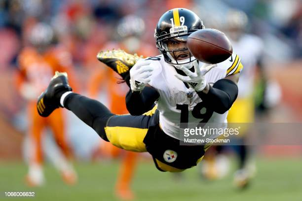 JuJu SmithSchuster of the Pittsburgh Steelers dives for athrown ball against the Denver Broncos at Broncos Stadium at Mile High on November 25 2018...