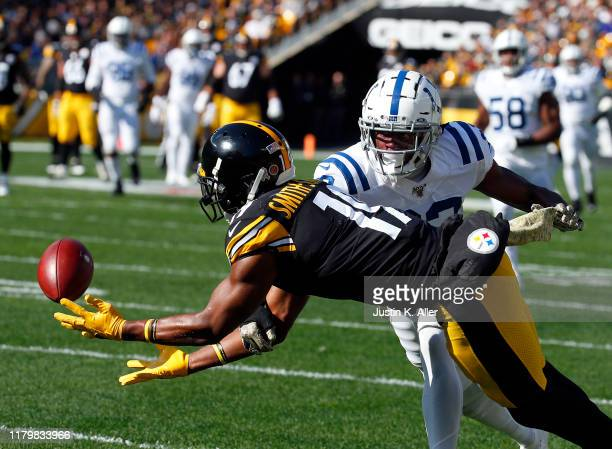 JuJu Smith-Schuster of the Pittsburgh Steelers drops a pass against the Indianapolis Colts on November 3, 2019 at Heinz Field in Pittsburgh,...