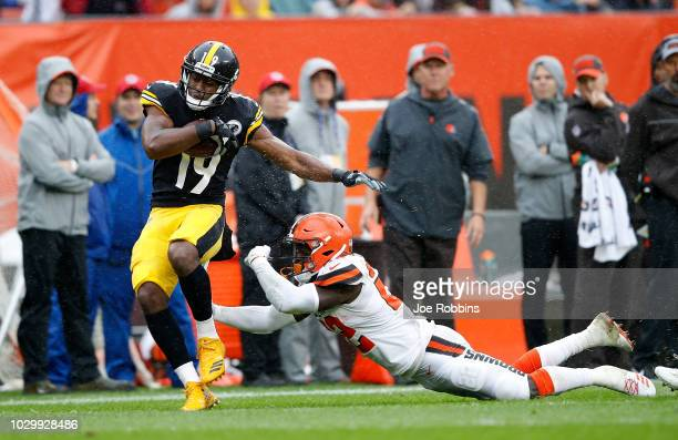 JuJu SmithSchuster of the Pittsburgh Steelers is pushed out of bounds by Damarious Randall of the Cleveland Browns during the first quarter at...
