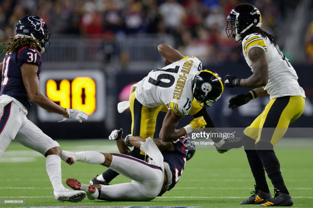 JuJu Smith-Schuster #19 of the Pittsburgh Steelers is tackled by Kevin Johnson #30 of the Houston Texans after a reception in the third quarter at NRG Stadium on December 25, 2017 in Houston, Texas.