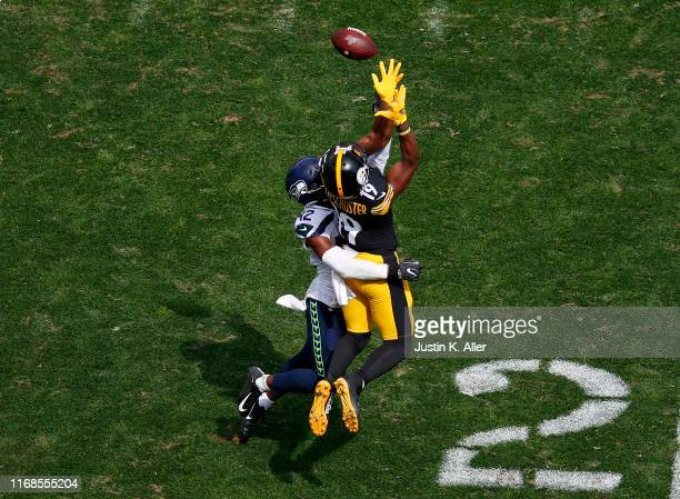 JuJu Smith-Schuster of the Pittsburgh Steelers makes a catch against Lano Hill of the Seattle Seahawks on September 15, 2019 at Heinz Field in...