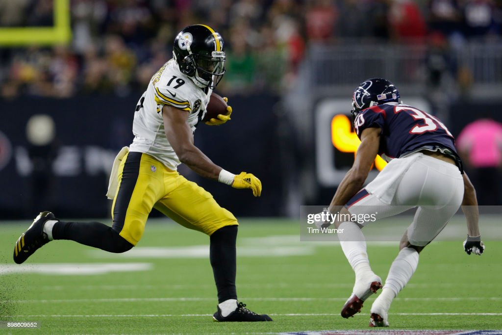 JuJu Smith-Schuster #19 of the Pittsburgh Steelers runs after a catch in the third quarter defended by Kevin Johnson #30 of the Houston Texans at NRG Stadium on December 25, 2017 in Houston, Texas.