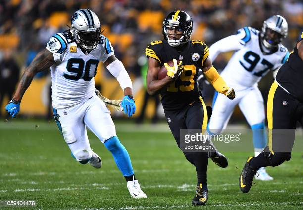 JuJu SmithSchuster of the Pittsburgh Steelers runs up field after a catch during the third quarter in the game against the Carolina Panthers at Heinz...