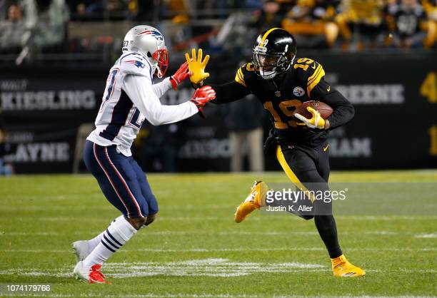 JuJu SmithSchuster of the Pittsburgh Steelers runs up field after a catch as JC Jackson of the New England Patriots attempts a tackle in the first...