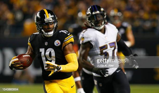 JuJu SmithSchuster of the Pittsburgh Steelers runs upfield as CJ Mosley of the Baltimore Ravens pursues in the first half during the game at Heinz...