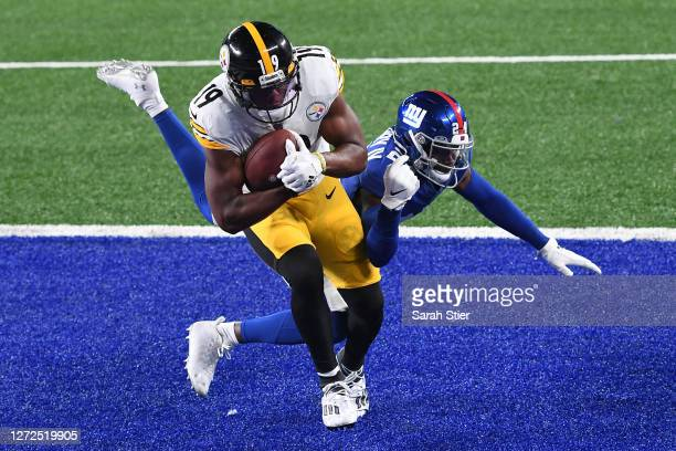 JuJu SmithSchuster of the Pittsburgh Steelers scores a touchdown as James Bradberry of the New York Giants defends during the second half at MetLife...