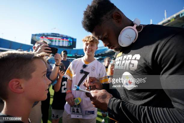 JuJu Smith-Schuster of the Pittsburgh Steelers signs autographs before their preseason game against the Carolina Panthers at Bank of America Stadium...
