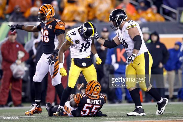 JuJu SmithSchuster of the Pittsburgh Steelers stands over Vontaze Burfict of the Cincinnati Bengals after a hit during the second half at Paul Brown...