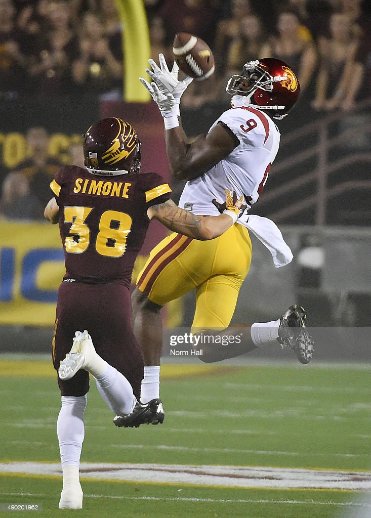 Juju Smith-Schuster #9 of the Southern California Trojans makes a first half catch in front of Jordan Simone #38 of the Arizona State University Sun Devils at Sun Devil Stadium on September 26, 2015 in Tempe, Arizona.