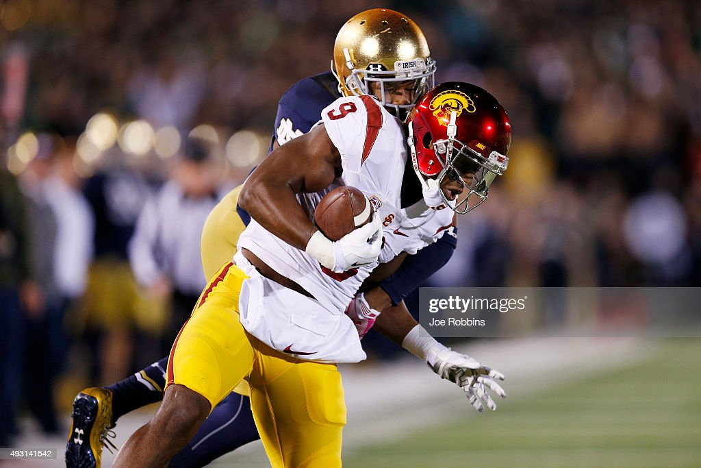 JuJu Smith-Schuster #9 of the USC Trojans makes a 37-yard reception for a first down against KeiVarae Russell #6 of the Notre Dame Fighting Irish in the first quarter of the game at Notre Dame Stadium on October 17, 2015 in South Bend, Indiana.