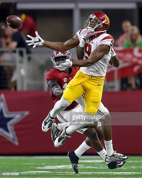 JuJu SmithSchuster tries to come up with a reception during the game between the USC Trojans and the Alabama Crimson Tide at ATT Stadium in Arlington...