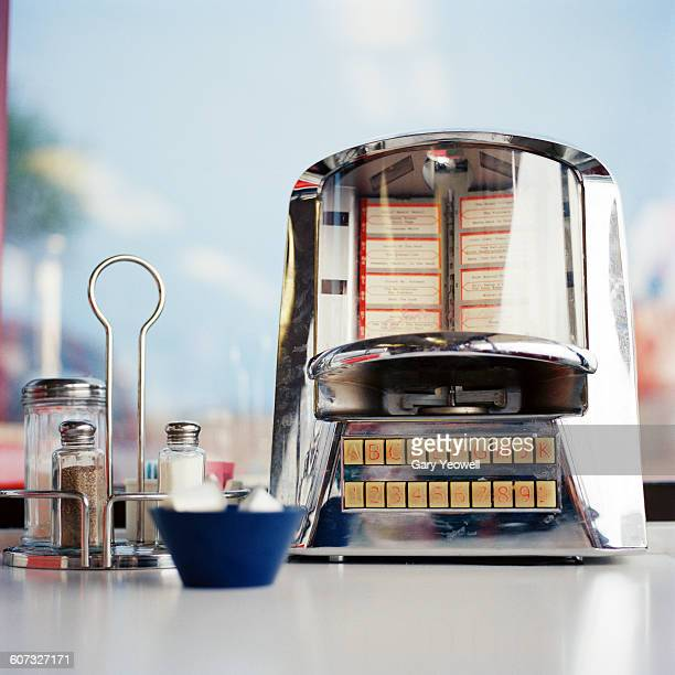 juke box and condiments on a diner table - diner stock pictures, royalty-free photos & images