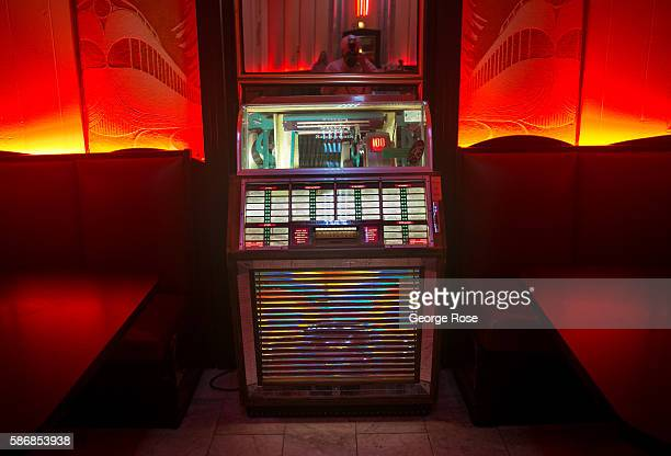 A jukebox bathed in red light sits in a corner of The Cruise Bar at The Oxford Hotel near Union Station on July 29 in Denver Colorado Denver the...