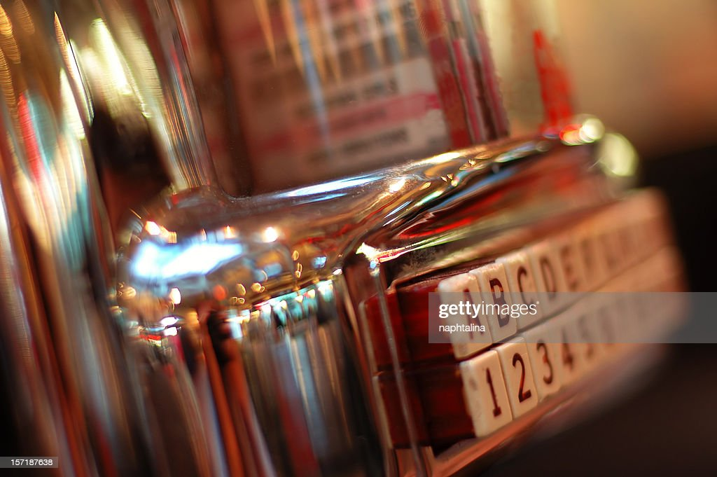 Jukebox on a blurred picture, vintage style : Stock Photo