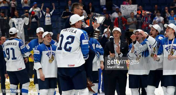 Jukka Jalonen, head coach of Finland celebrate with the trophy after winning the gold medal game over Canada during the 2019 IIHF Ice Hockey World...