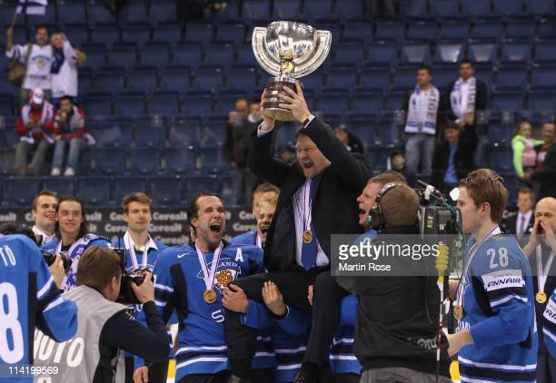 Jukka Jalonen, headcoach of Finland lifts the trophy after winning the IIHF World Championship gold medal match between Sweden and Finland at Orange...