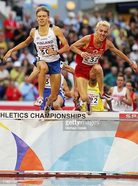 Jukka Keskisalo of Finland and Jose Luis Blanco of Spain clear the water jump during the Men's 3000 Metres Steeplechase Final on day five of the 19th...