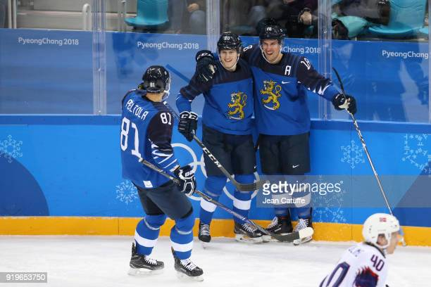 Jukka Peltola Eeli Tolvanen and Sami Lepisto of Finland celebrate during the Men's Ice Hockey Preliminary game between Finland and Norway at...