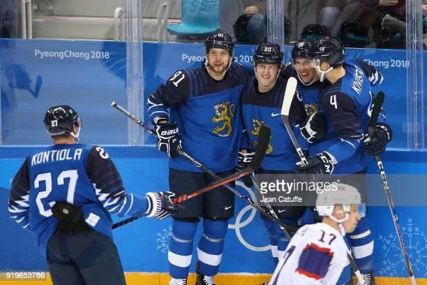 Jukka Peltola Eeli Tolvanen Sami Lepisto and Tommi Kivisto of Finland celebrate during the Men's Ice Hockey Preliminary game between Finland and...