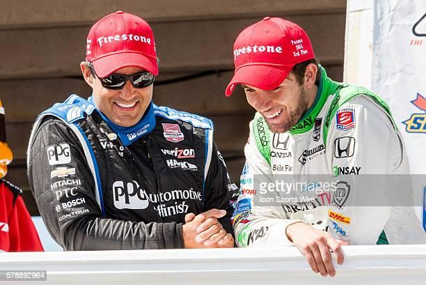 Juan Pablo Montoya and Carlos Munoz celebrate in victory lane after the Pocono INDYCAR 500 at Pocono Raceway in Long Pond PA