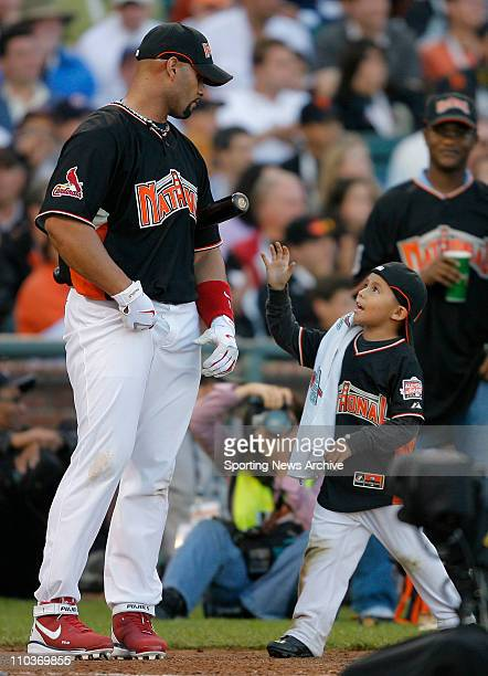 Jul 09 2007 San Francisco CA USA ALBERT PUJOLS of the Cardinals is consoled by his son AJThe 2007 State Farm Home Run Derby takes place at ATT Park...