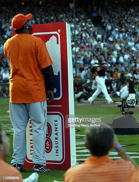 Jul 09 2007 San Francisco CA USA DAVID ORTIZ of the Red Sox shields himself from foul balls from RYAN HOWARD of the Phillies The 2007 State Farm Home...