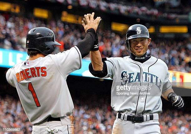 Jul 10 2007 San Francisco CA USA ICHIRO SUZUKI of the Mariners accepts congratulations from BRIAN ROBERTS of the Orioles after the first inside the...