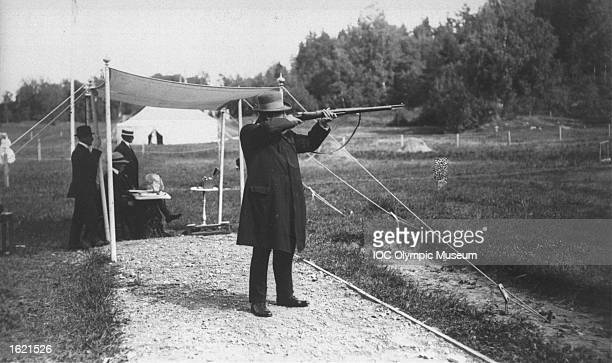Oscar Swahn of Sweden aiming at a target during the Running Deer Shooting event at the 1912 Olympic Games in Stockholm, Sweden. Swahn won the...