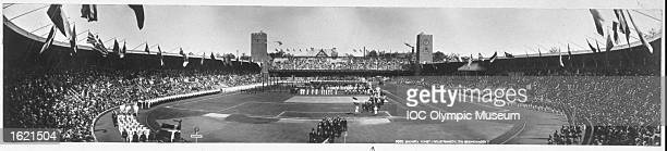 Panoramic view of the delegations gathered in the Olympic Stadium during the Opening Ceremony at the 1912 Olympic Games in Stockholm, Sweden. \...