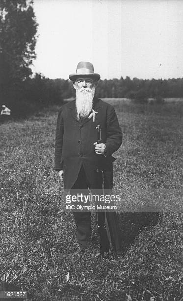 Portrait of Oscar Swahn of Sweden, a competitor in the Running Deer Shooting event, standing with his rifle during the 1912 Olympic Games in...