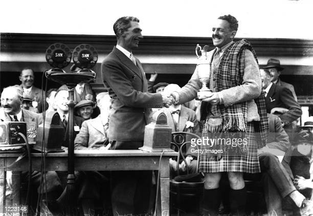 Tommy Armour of Scotland receives the Claret Jug after victory in the British Open at Carnoustie Scotland Mandatory Credit AllsportUK/Allsport