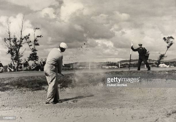 South African golfer Bobby Locke holder of the Open title plays out of the bunker at the 8th at Carnoustie Mandatory Credit Allsport Hulton/Archive
