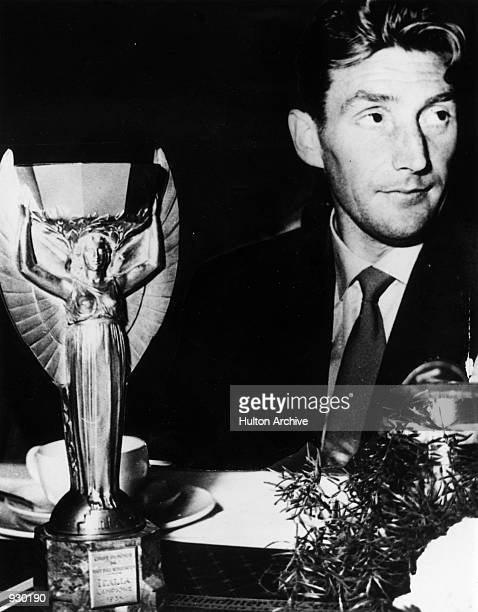 Fritz Walter of West Germany poses with the Jules Rimet trophy after winning the FIFA World Cup Final against Hungary played in Berne Switzerland...